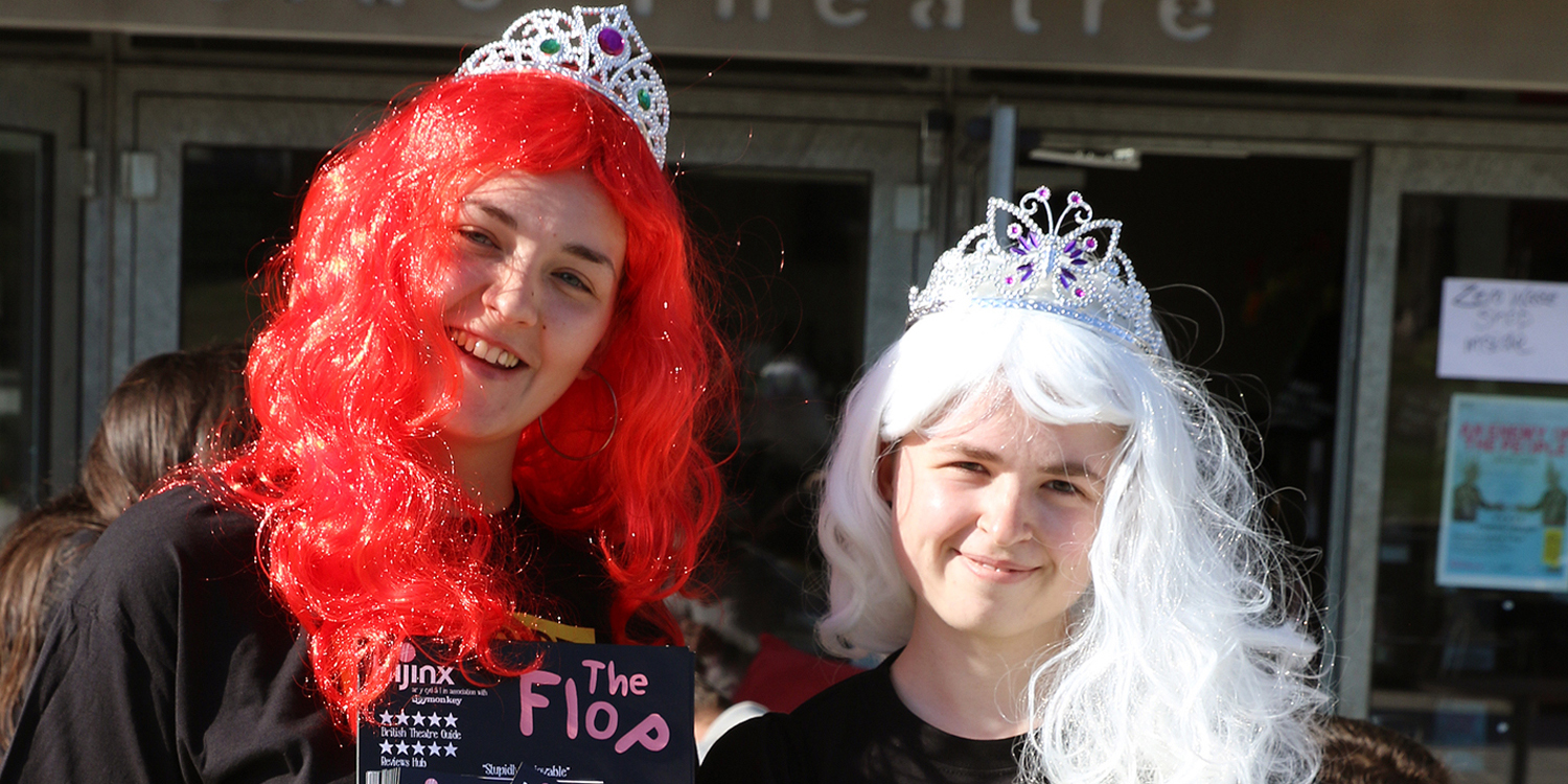 Students in wigs flyering the show